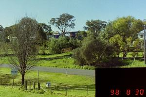 Distant view of house clad in blue