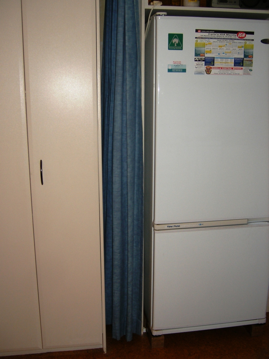 Photo of fridge and curtain