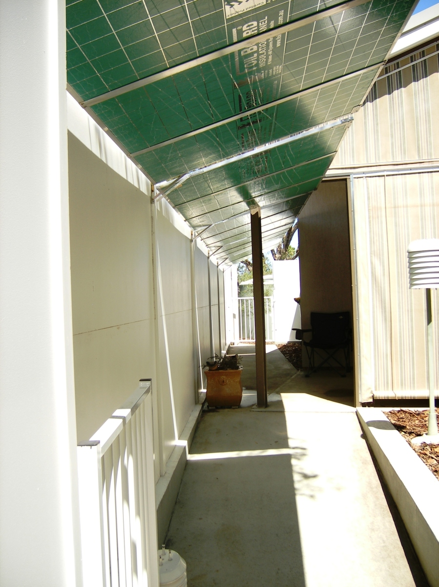 Sun mirror panels that warm the house in winter, shade the courtyard in summer.