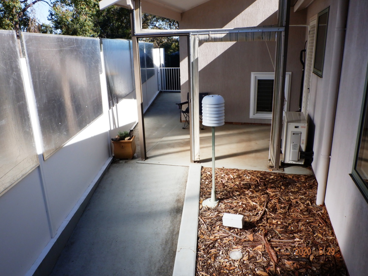 By 12.35 sun mirrors spread light to the floor of the patio and courtyard and the laundry wall.